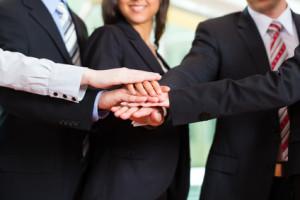 Business - eine Gruppe von Geschäftsleuten in einem Büro
